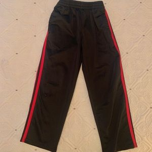 4.$15 Starter black and red track pants 6/7